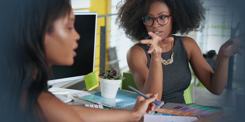 Two African American business women in a meeting