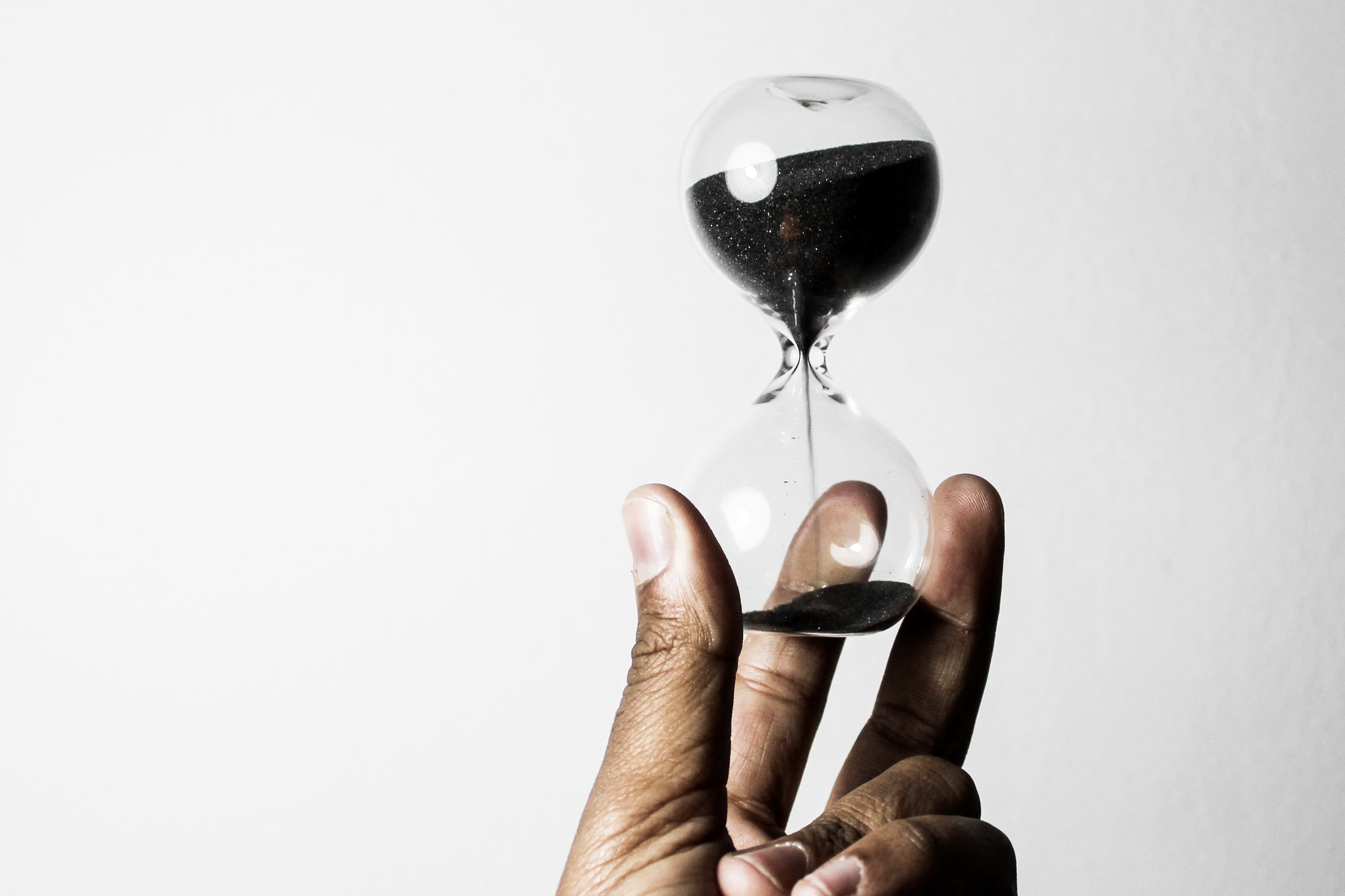 hand holding an hour glass