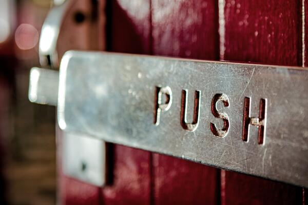 """Image by Tim Mossholder, door labeled """"push"""""""