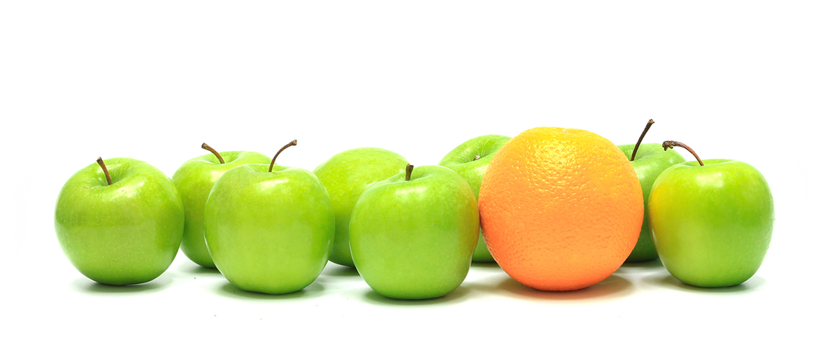 Photo of apples with one orange