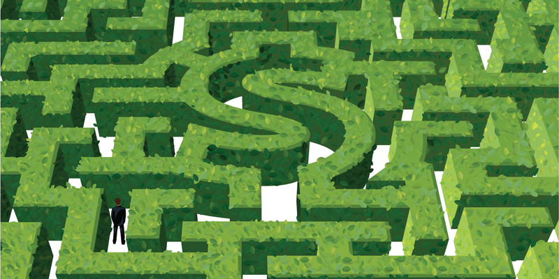 businessperson navigating Money-Shaped maze